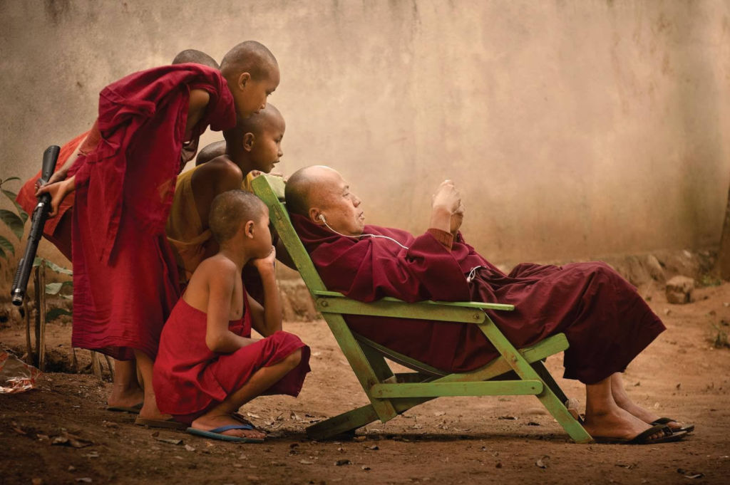 Group of Young Monks discovers an iPod