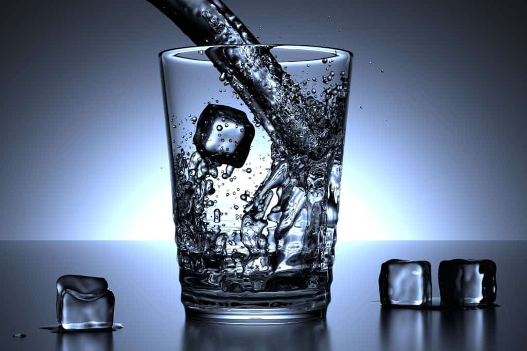 filling water in glass with ice (rendered image)