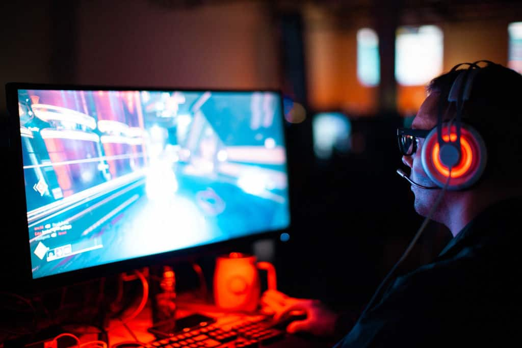 a gamer playing a PC game