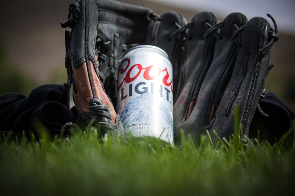 coors light can of beer in a baseball glove