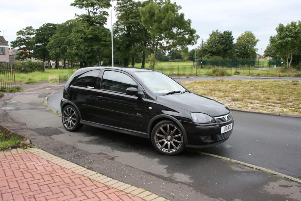 Opel Corsa with tinted windows on a driveway