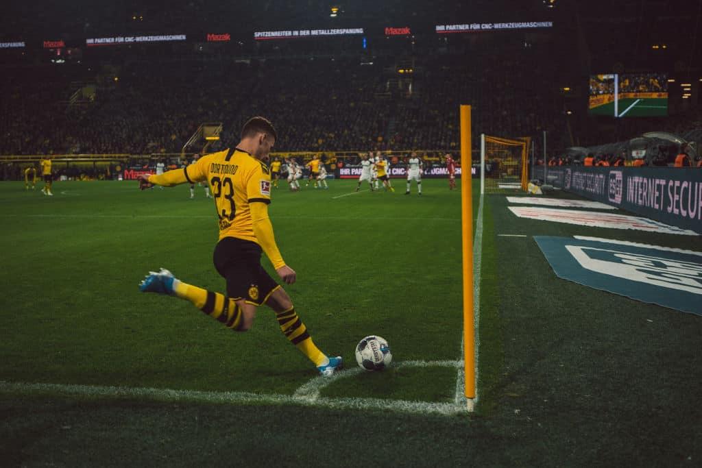 player taking corner kick in soccer