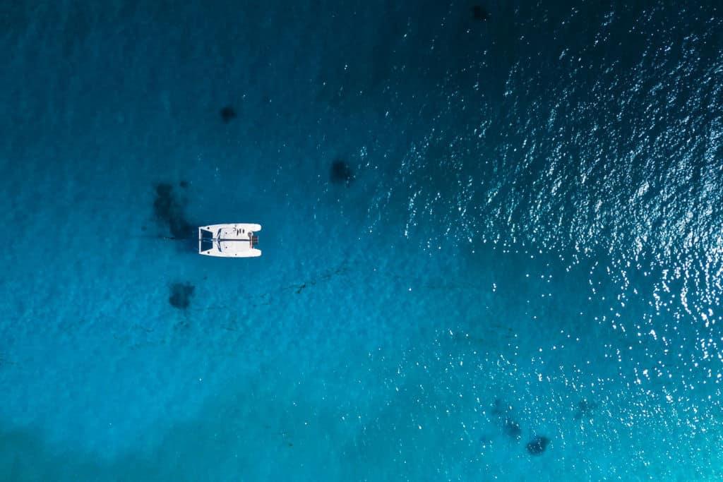 catamaran in shallow waters sailing the world
