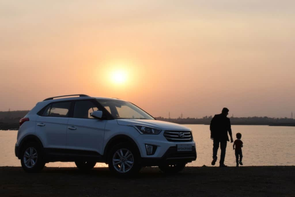 silhouette of father and son at the beach Hyundai car insurance