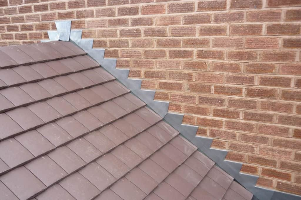 You are currently viewing What is Roof Flashing? (Types, Cost & Materials)
