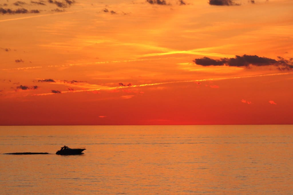 sailing lake Michigan in sunset